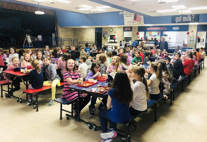 Boyne City Elementary School third grade students eat their lunch in the school's cafeteria Wednesday. None of them, or any of the district's students in grades K-8 have any lunch debt thanks to an anonymous donor.