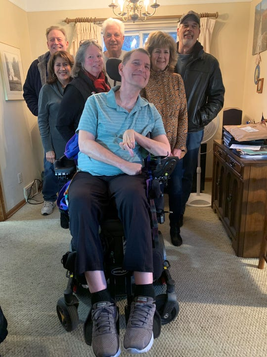Bob Trumble of Dearborn meets with a group of friends every Wednesday to brainstorm ways to help him pay medical bills so he can stay in his home. Many of them have known each other since elementary school.
