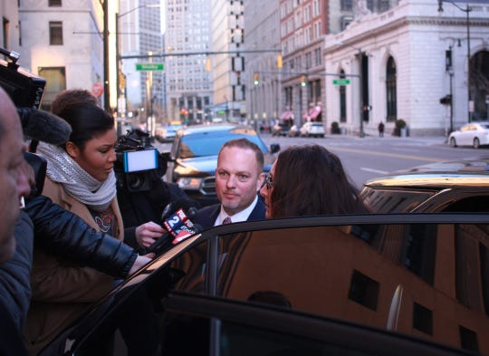 Taylor Mayor Rick Sollars leaves the Theodore Levin U.S. Courthouse and is interviewed by members of the media in Detroit, Michigan on December 19, 2019.