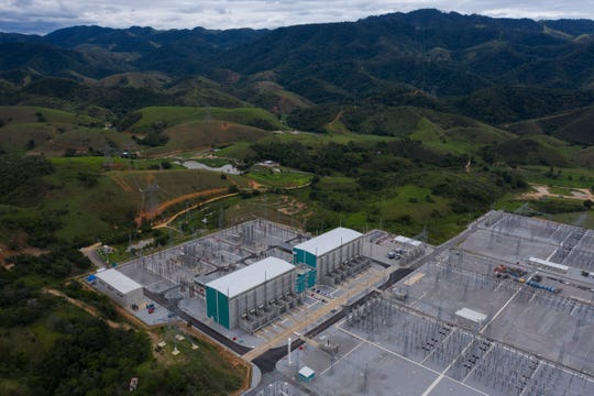 In this Dec. 4, 2019 aerial photo, the Xingu Rio Energy Transmitter (XRTE Rio) power transmission substation operates in Paracambi, Brazil, transmitting the electrical power that comes from Belo Monte Dam.