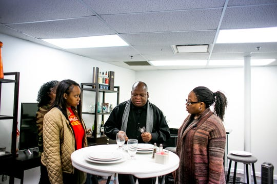 Jesse Fairs, center, of West Bloomfield leads a banquet service class at the Detroit Artist Test Lab.
