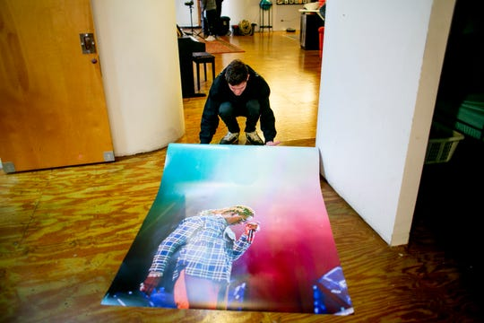 Adi Muhtarevic, 19, of Clinton Township rolls up one of his photos at the Detroit Artist Test Lab, a workshop and gathering spot for artists, teachers and the community to create and learn and teach.