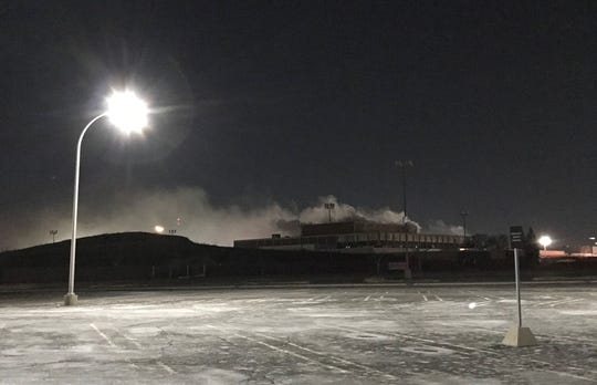 No flames were visible against the night sky Thursday morning. The former buildings that once made up the popular shopping venue closest to Northwestern Highway appeared intact.