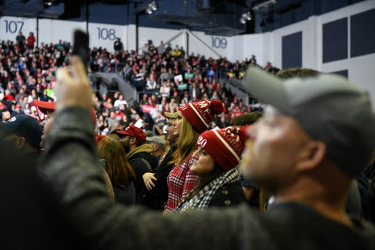 Supporters listen while President Donald Trump speaks at Kellogg Arena in Battle Creek, Mich. on Dec. 18, 2019.