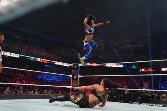 WWE Superstar Bayley flies through the air.