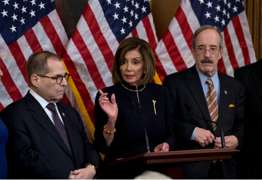 Speaker of the House Nancy Pelosi, D-Calif., addresses reporters Wednesday, Dec. 18, 2019, after the House voted to impeach President Donald Trump on two charges. She is joined House Judiciary Committee Chairman Jerrold Nadler, D-N.Y., and House Foreign Affairs Committee Chairman Eliot Engel, D-N.Y.