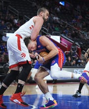 Pistons' Blake Griffin trips up and runs into Raptors' Marc Gasol in the first quarter of the 112-99 Toronto victory at Little Caesars Arena in Detroit, Michigan on December 18, 2019.