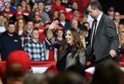 Ronna McDaniel, chair of the Republican National Committee waves as she steps from the stage next to Michigan Republican Party co-chair Terry Bowman, right.