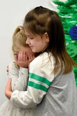 Kate Meldrum, left, pretends to be crying as Elianna Peterson hugs her to demonstrate how to be kind to a person if he or she is not having a good day, at The Learning Experience in South Lyon.