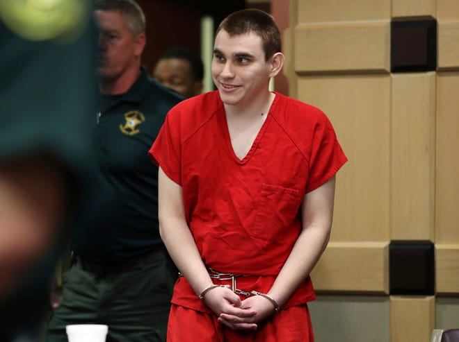Parkland school shooting suspect Nikolas Cruz enters the courtroom for a hearing at the Broward Courthouse in Fort Lauderdale, Fla., Tuesday, Jan. 15, 2019.