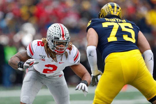 Ohio State defensive end Chase Young (2) rushes against Michigan offensive lineman Jon Runyan during a game this season.