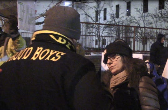 Linda Bradley, Grand Haven, 55, came to protest President Donald Trump Wednesday and ended up having a cordial conversation with a member of the right-wing group Proud Boys that ended with a smile and a fist bump. December 18, 2019