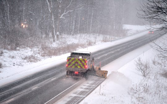 Pennsylvania Department of Transpiration plow truck clears snow from southbound lanes of Interstate 79 on Wednesday, Dec. 18, 2019. Snow across the state was blamed for a massive crash on Interstate 80.