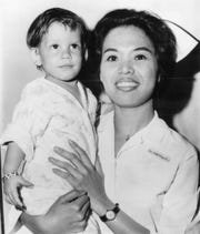 "FILE - In this June 17, 1966 file photo, a boy, dubbed ""Scott McKinley"" by the State Child Service is held by Nurse Lolita V. Tana in Newark, N.J. McKinley has been adopted by Chester and Dora Fronczak, a Chicago couple who believe him to be their son kidnapped in 1964."