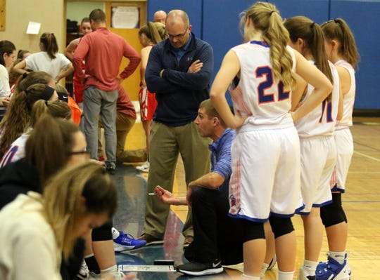 Thomas A. Edison head coach Chris Mallette talks to his players during a 69-36 loss to Waverly in girls basketball Dec. 18, 2019 in Elmira Heights.