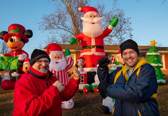 Roger Claridge, left, and Jonathan Crowe have built up a bit of a competition when it comes to holiday yard inflatables. The two Warrick County neighbors live on Telephone Road just east of Bell Road and have had their collection multiply to more than 100 over the past two seasons.
