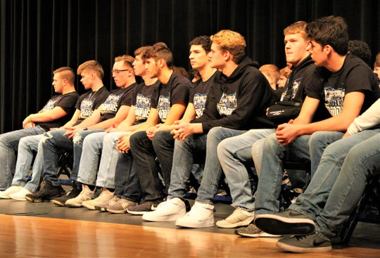 Members of the Fliers Varsity Football team sit on stage in front of a crowd of nearly 800 family and fans during the Clyde Community Celebration for the Clyde Flier Football 2019 State Championship on Dec. 18.