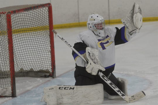 Fort Collins hockey goaltender Noah Winbourn makes a glove save during a game against Dakota Ridge at NoCo Ice Center on Thursday, Dec. 19, 2019. The No. 4 Lambkins won 6-3.