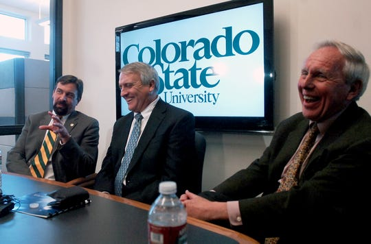 Colorado State University Chancellor emeritus Joe Blake, right, is pictured with then-President Tony Frank and then-Colorado Gov. Bill Ritter during a 2011 press conference. The university on Thursday announced a $5 million donation from Blake to its College of Liberal Arts.