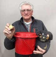 Salvation Army volunteer Robert Thompson shows a gold Krugerrand found in his kettle Dec. 16, 2019 in Fort Collins.