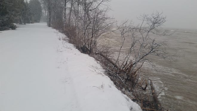 Bushes are all that stand between Lake Michigan and South Lake Michigan Drive in the town of Clay Banks in Door County in this photo from Dec. 12.