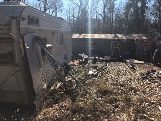 Greenville County deputies found a man's body buried on a blighted Greer property.