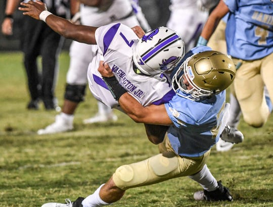 DW Daniel senior Tyler Venables(24) sacks Ridge View sophomore Andre Washington(7) during a game at D.W. Daniel High School in September. Venables, the son of  Clemson football Defensive Coordinator Brent Venables,  is one in the 2020 class, rated top in the nation.