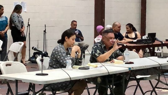 Mayors' Council of Guam Executive Director Angel Sablan, right, gestures as he addresses Yona residents, while Vice Speaker Telena Nelson looks on, during a Dec. 18, 2019 town hall on public safety.