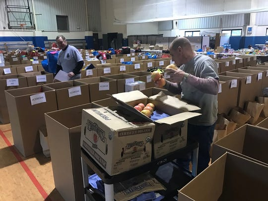Henderson County Jail trustees work to pack food boxes for the Salvation Army (December 2019).