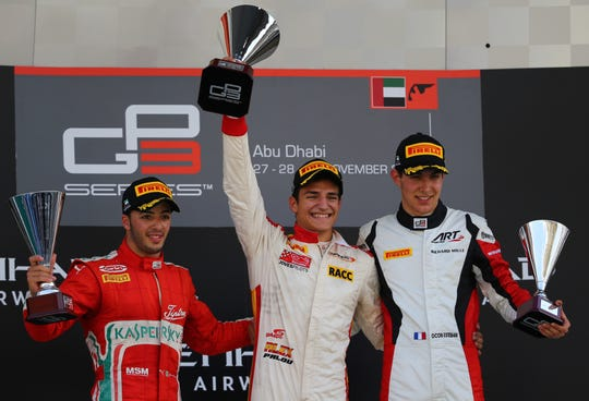 Alex Palou, center, celebrates his victory  at the Yas Marina circuit in Abu Dhabi on November 29, 2015, after the Abu Dhabi GP 3 Grand Prix.