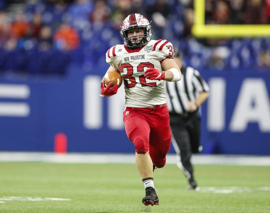 New Palestine Dragons running back Charlie Spegal (32) rushes the bal for an 80 yard touchdown at the IHSAA Class 5A state finals at Lucas Oil Stadium, Friday, November 29, 2019. New Palestine Dragons has an undefeated season beating Valparaiso Vikings in the state finals, 27-20.