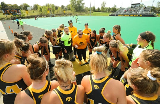 Iowa field hockey coach Lisa Cellucci talks with her players before a game this fall at Grant Field. The former Hawkeye star wants to lead the program back to the prominence it once had.