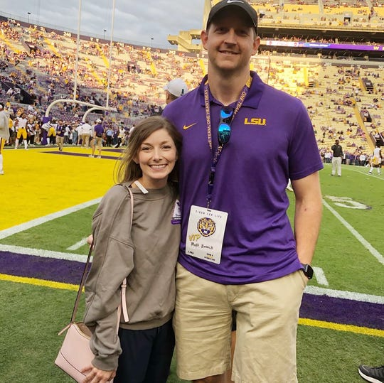 Photographed at a Louisiana State University football game with his wife Liana Branch, Matt Branch, a former LSU offensive lineman, said this year's football season has helped his recovery from a leg amputation.