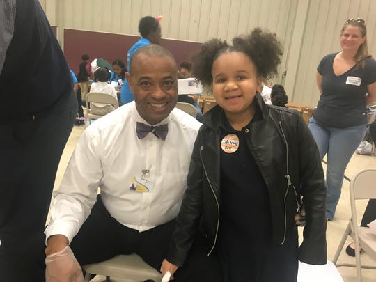 Andrew Jackson Elementary student Aubrey Price was glad to sit down with Jackson-Madison County Schools Superintendent Ray Washington and get a new pair of shoes.
