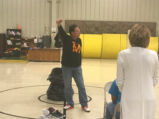 Samaritans' Feet representative Phil Campbell talks to about 70 volunteers from Jackson before students arrive to receive new shoes at Andrew Jackson Elementary on Thursday.