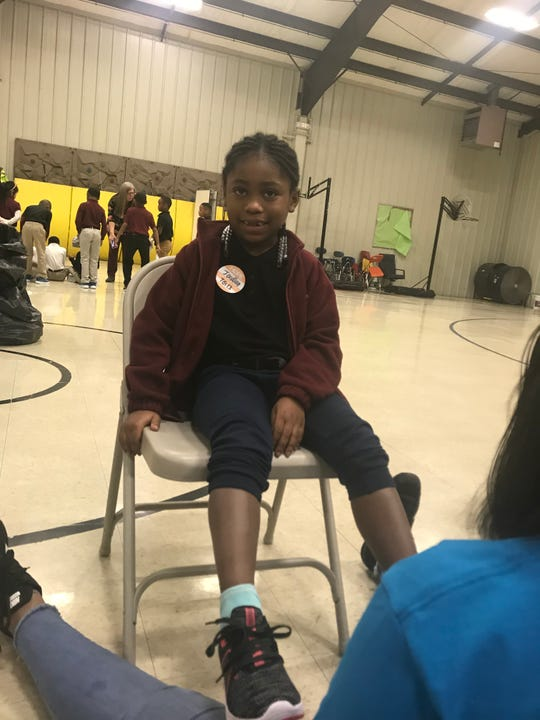 Andrew Jackson Elementary student Jordian Neal shows off the shoes that she'd just received on Thursday.