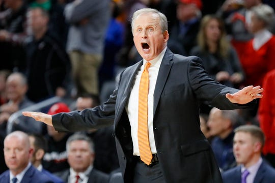 Tennessee head coach Rick Barnes directs his players from the bench during the first half of an NCAA college basketball game against Cincinnati, Wednesday, Dec. 18, 2019, in Cincinnati. (AP Photo/John Minchillo)