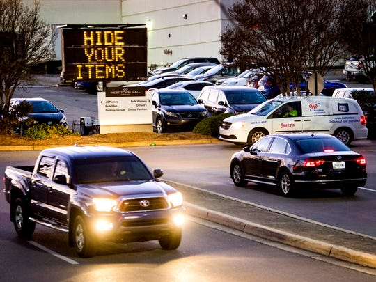 "A sign recommending shoppers to ""Hide Your Items"" and ""Lock Your Car"" greets drivers at West Town Mall on Wednesday, Dec. 18, 2019."
