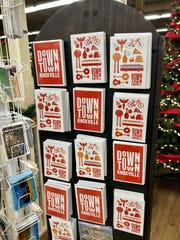 """""""The guests love the wooden posters and the coffee mugs – they are great gift  items and go well in gift baskets,"""" said Natalea Riley, general manager of Mast General Store in Knoxville."""