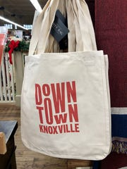 A tote at Mast General Store features the refreshed Downtown Knoxville logo.
