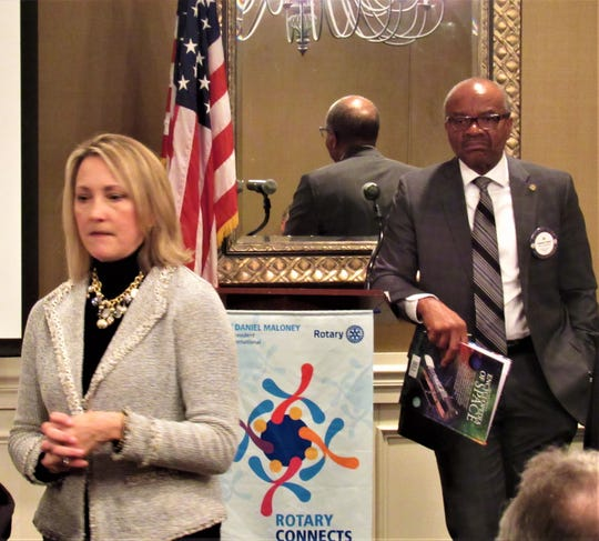 Debbie Morris answered audience questions after her presentation at Fox Den Country Club while Farragut Rotary President-Elect Ed Jones looked on.