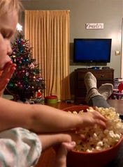 Homestyle podcast host Leigh Guidry tries to hold on to a bowl of popcorn as her kids attack it, preparing for family movie night. This episode of Homestyle gives tips and ideas for what to eat and watch on a movie night in or out. Find it on your favorite podcast app or at theadvertiser.com.