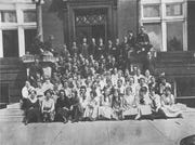 This photo shows the junior class attending Lancaster High School in 1919. The school was located on E. Mulberry St.  Several students drove automobiles to school 100 years ago. Photo is from the 1919 Mirage.