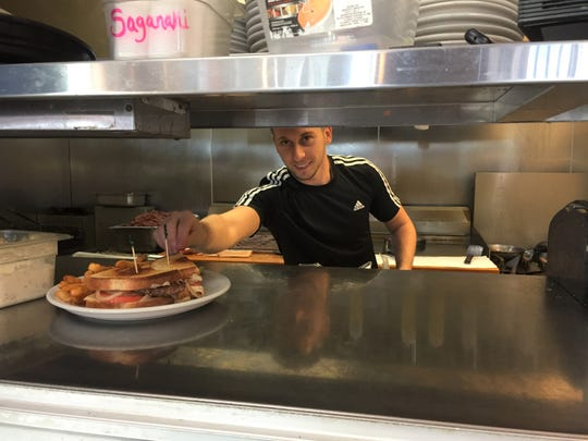 Robert Domgjoni, the new owner of George's Restaurant in Howell, formerly George's Coney & Grill, shown Thursday, Dec. 19, 2019, cooks there every day.