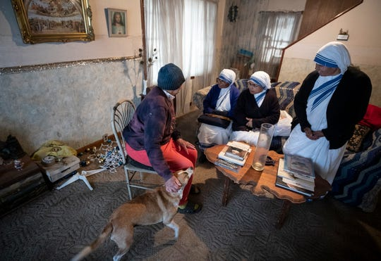Catholic nuns from the Missionaries of Charity order visit with Jenny Brewer, 80, in her home in  Jenkins, Ky. The sisters found Brewer's only heat to be from a hair dryer and arranged for her to have a space heater.Nov. 15, 2019.