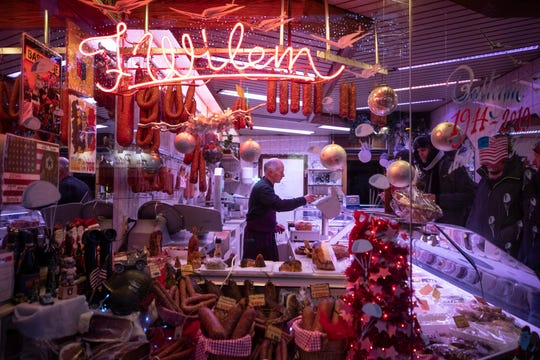 The scene through the window of a butcher shop on Rue du Sablon, in Bastogne, Belgium. Dec. 14, 2019