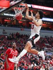 Jordan Nwora throws down a dunk against Miami.