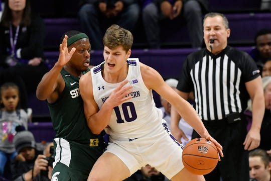 Dec 18, 2019; Evanston, IL, USA; Northwestern Wildcats forward Miller Kopp (10) dribbles the ball against Michigan State Spartans guard Cassius Winston (5) in the first half at Welsh-Ryan Arena. Mandatory Credit: Quinn Harris-USA TODAY Sports