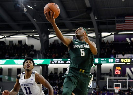 Dec 18, 2019; Evanston, IL, USA; Michigan State Spartans guard Cassius Winston (5) shoots a layup in the first half against Northwestern Wildcats guard Anthony Gaines (11) at Welsh-Ryan Arena. Mandatory Credit: Quinn Harris-USA TODAY Sports