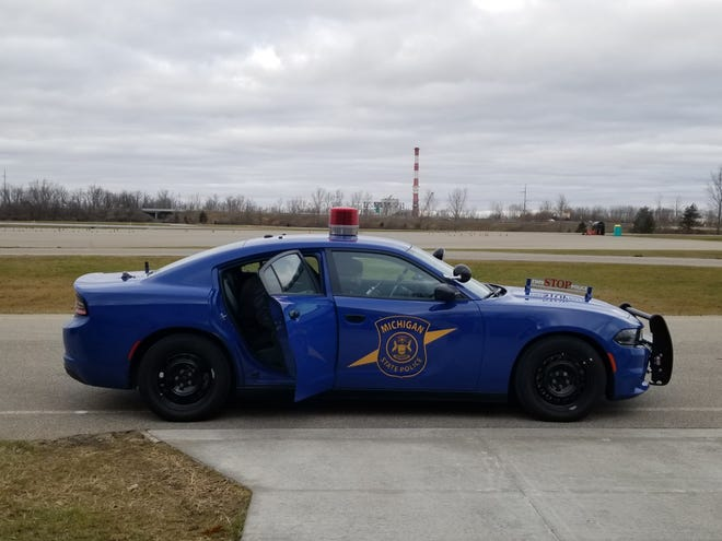 Engineers demonstrated the results of research conducted by the U.S. Army CCDC Ground Vehicle Systems Center and the Michigan State Police on a MSP patrol vehicle on Dec. 6, 2019. The organizations are studying ways to keep vehicle systems more secure from harmful attacks or unauthorized access.